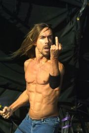 Iggy Pop on stage at the Carling Festival, Reading. Live. Half Length.
